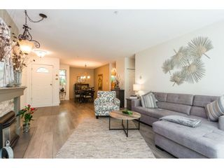 """Photo 7: 102 2733 ATLIN Place in Coquitlam: Coquitlam East Condo for sale in """"ATLIN COURT"""" : MLS®# R2475795"""