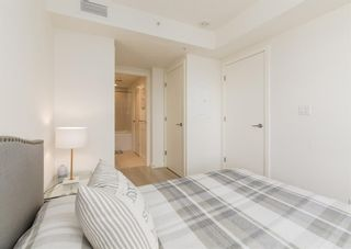 Photo 17: 406 108 Waterfront Court SW in Calgary: Chinatown Apartment for sale : MLS®# A1108137