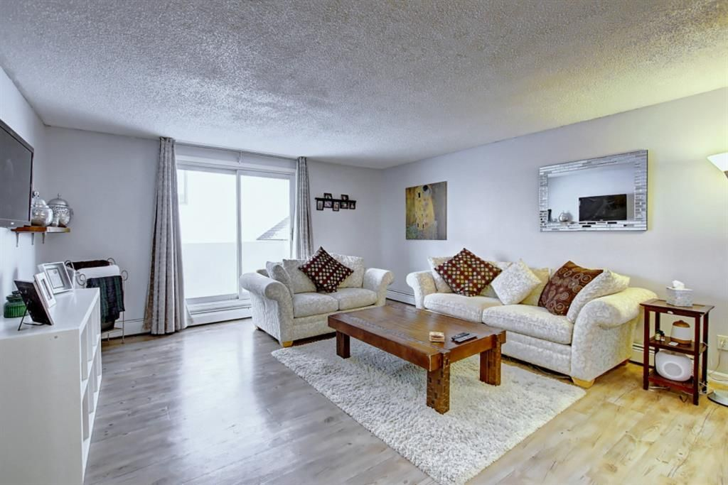 Living room is a great size and leads out to your own balcony