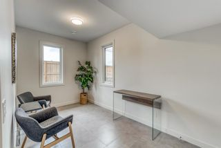 Photo 5: 98 23 Street NW in Calgary: West Hillhurst Row/Townhouse for sale : MLS®# A1066637