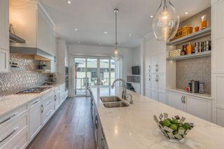 Photo 9: 2044 52 Avenue SW in Calgary: North Glenmore Park Detached for sale : MLS®# A1084316