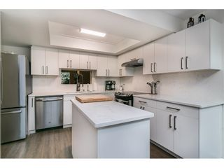 """Photo 1: 8204 FOREST GROVE Drive in Burnaby: Forest Hills BN Townhouse for sale in """"HENLEY ESTATES"""" (Burnaby North)  : MLS®# R2621555"""