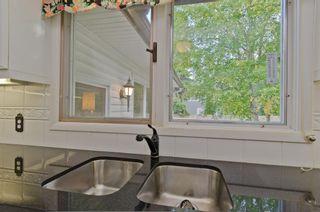 Photo 17: 7208 11 Street SW in Calgary: Kelvin Grove Detached for sale : MLS®# A1079702