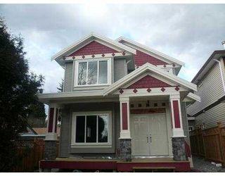 Photo 1: 615 EDGAR Avenue in Coquitlam: Coquitlam West 1/2 Duplex for sale : MLS®# V777992
