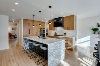 Photo 12: 1011 80 Avenue SW in Calgary: Chinook Park Detached for sale : MLS®# A1071031