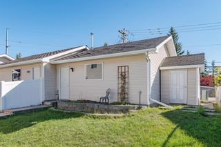 Photo 32: 48 West Springs Way SW in Calgary: West Springs Row/Townhouse for sale : MLS®# A1148807