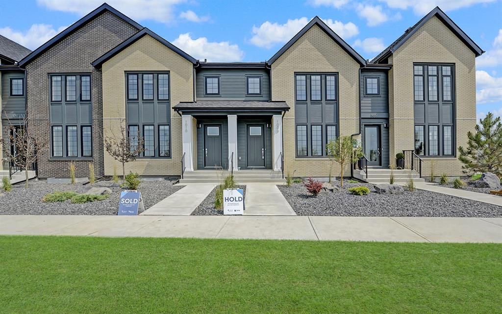 Main Photo: 1042 Harmony Parade in Rural Rocky View County: Rural Rocky View MD Row/Townhouse for sale : MLS®# A1136915