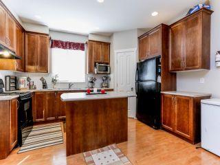 Photo 4: 5852 148TH Street in Surrey: Sullivan Station 1/2 Duplex for sale : MLS®# F1407622