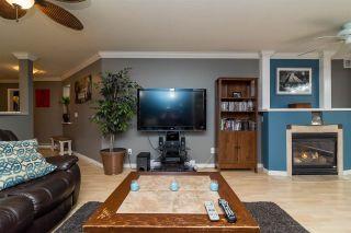 "Photo 10: 102 20268 54 Avenue in Langley: Langley City Condo for sale in ""BRIGHTON"" : MLS®# R2160975"