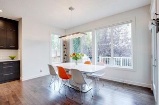 Photo 5: 127 Springbluff Boulevard SW in Calgary: Springbank Hill Detached for sale : MLS®# A1140601
