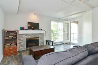 "Photo 3: 202 14980 101A Avenue in Surrey: Guildford Condo for sale in ""Cartier Place"" (North Surrey)  : MLS®# R2586660"