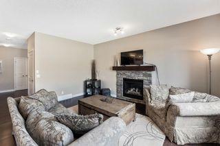 Photo 10: 205 Heritage Boulevard: Cochrane Detached for sale : MLS®# A1122442
