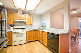 """Photo 5: 8229 VIVALDI Place in Vancouver: Champlain Heights Townhouse for sale in """"ASHLEIGH HEIGHTS"""" (Vancouver East)  : MLS®# R2331263"""