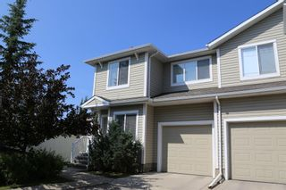 Photo 1: 84 BRIDLERIDGE Manor SW in Calgary: Bridlewood Row/Townhouse for sale : MLS®# A1029938