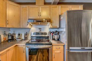 Photo 6: 25 200 HIDDEN HILLS Terrace in Calgary: Hidden Valley Row/Townhouse for sale : MLS®# A1022696