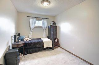 Photo 25: 39 Riverview Close: Cochrane Detached for sale : MLS®# A1079358