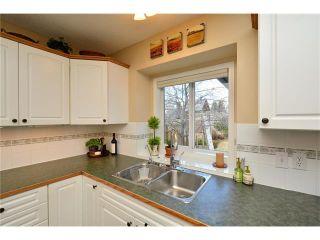 Photo 11: 108 GLENEAGLES Terrace: Cochrane House for sale : MLS®# C4113548