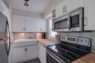 Photo 6: 42 Quentin Place SW in Calgary: Garrison Woods Semi Detached for sale : MLS®# A1122774