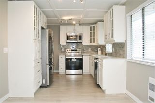 """Photo 9: 33358 4TH Avenue in Mission: Mission BC House for sale in """"Lane off Murray"""" : MLS®# R2252998"""