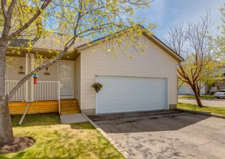 Photo 1: 136 MT ABERDEEN Manor SE in Calgary: McKenzie Lake Row/Townhouse for sale : MLS®# A1109069