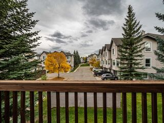Photo 27: 27 Sandarac Road NW in Calgary: Sandstone Valley Row/Townhouse for sale : MLS®# A1148451