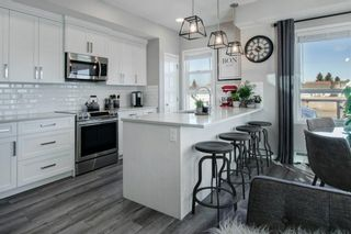 Photo 2: 211 370 Harvest Hills Common NE in Calgary: Harvest Hills Apartment for sale : MLS®# A1060358