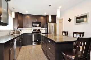 Photo 6: 1590 ELINOR CRESCENT in Port Coquitlam: Mary Hill House for sale : MLS®# R2408998