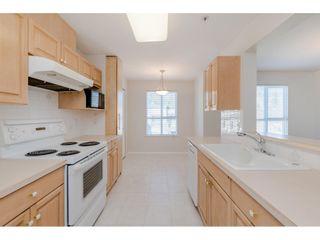 "Photo 11: 406 13870 70 Avenue in Surrey: East Newton Condo for sale in ""CHELSEA GARDENS"" : MLS®# R2450368"