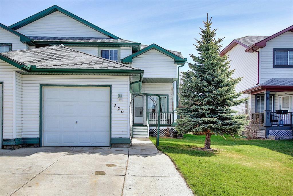 Main Photo: 226 Quigley Drive: Cochrane Semi Detached for sale : MLS®# A1107845