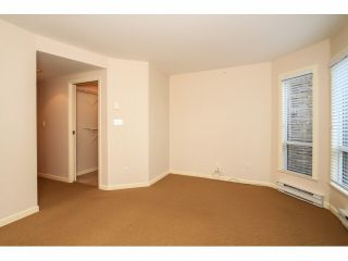 "Photo 12: 103 9978 148TH Street in Surrey: Guildford Condo for sale in ""HIGHPOINT GARDENS"" (North Surrey)  : MLS®# F1430440"