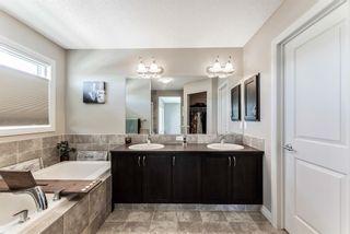 Photo 17: 205 Heritage Boulevard: Cochrane Detached for sale : MLS®# A1122442