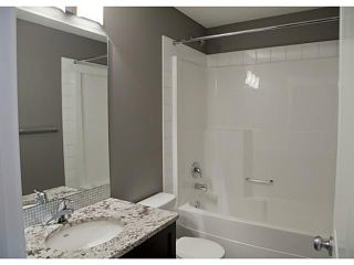 Photo 14: 452 Rainbow Falls Drive: Chestermere Townhouse for sale : MLS®# C3579282