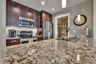 """Photo 8: 105 2238 WHATCOM Road in Abbotsford: Abbotsford East Condo for sale in """"Waterleaf"""" : MLS®# R2610127"""