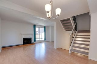 Photo 2: 1102 2520 Palliser Drive SW in Calgary: Oakridge Row/Townhouse for sale : MLS®# A1140077