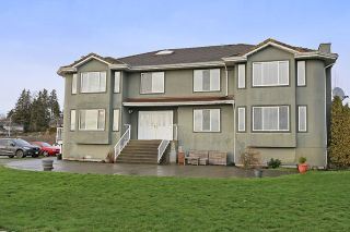 Photo 1: 17040 57 Avenue in Surrey: Cloverdale BC House for sale (Cloverdale)  : MLS®# R2037607