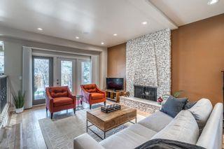 Photo 7: 424 135 Avenue SE in Calgary: Lake Bonavista Detached for sale : MLS®# A1095373