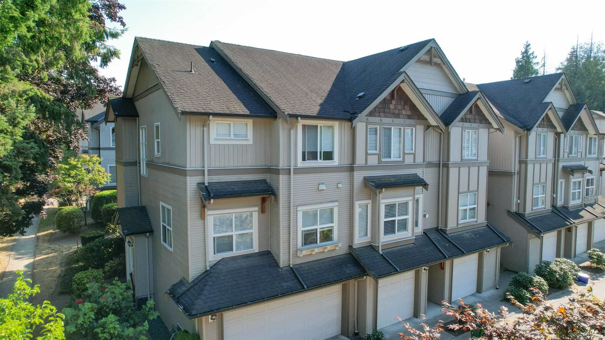 "Main Photo: 52 12677 63 Avenue in Surrey: Panorama Ridge Townhouse for sale in ""Sunridge Estate"" : MLS®# R2607513"