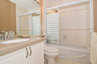 """Photo 16: 6139 W BOUNDARY Drive in Surrey: Panorama Ridge Townhouse for sale in """"LAKEWOOD GARDENS"""" : MLS®# F1448168"""