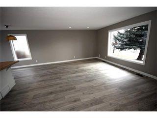 Photo 4: 20 ALCOCK Street: Okotoks House for sale : MLS®# C4104767
