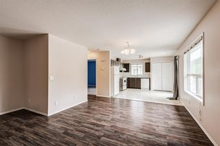 Photo 13: 6633 Pinecliff Grove NE in Calgary: Pineridge Row/Townhouse for sale : MLS®# A1128920