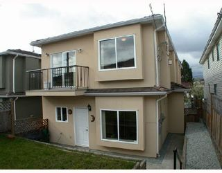 Photo 1: 4952 DOMINION Street in Burnaby: Central BN 1/2 Duplex for sale (Burnaby North)  : MLS®# V702179