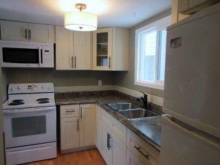 """Photo 2: 8838 101ST Avenue in FT ST JOHN: Fort St. John - City NE Townhouse for sale in """"GLENWOOD COMPLEX"""" (Fort St. John (Zone 60))  : MLS®# N245571"""