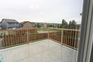 Photo 13: 118 Panamount Villas NW in Calgary: Panorama Hills Detached for sale : MLS®# A1147208