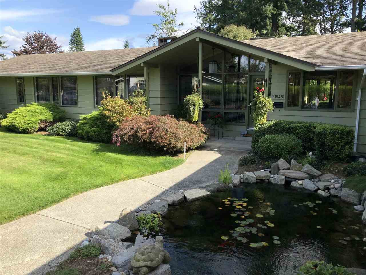 A long level driveway and professionally installed pond welcome you home.