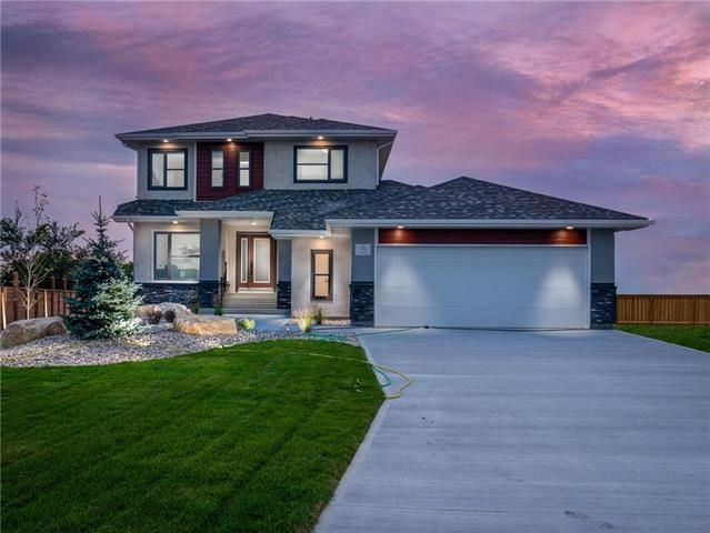 Welcome! Gorgeous curb appeal, beautiful landscaping, oversized garage and wide front drive/walkway!