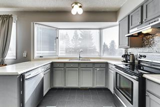 Photo 2: 31 Stradwick Place SW in Calgary: Strathcona Park Semi Detached for sale : MLS®# A1091744