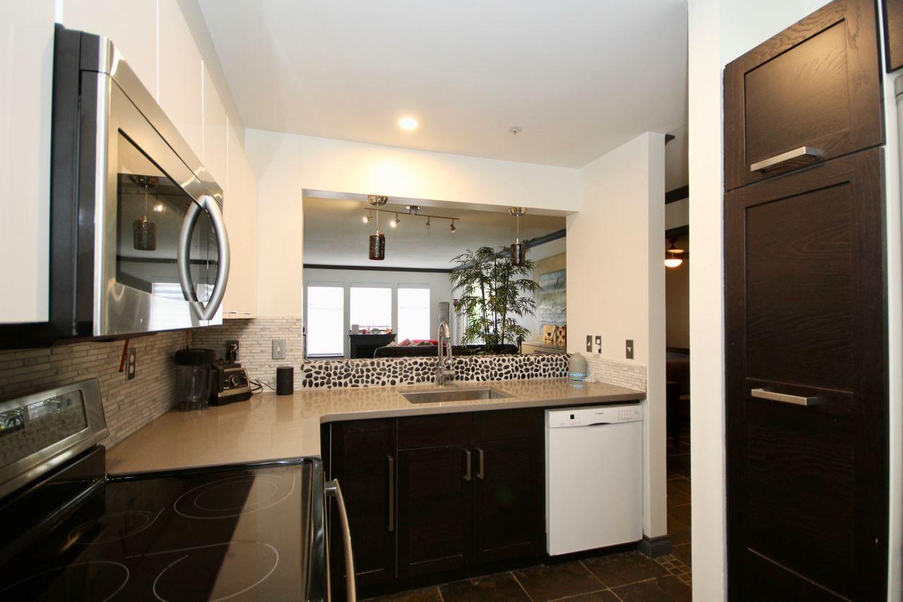 "Main Photo: 201 1369 56 Street in Delta: Cliff Drive Condo for sale in ""WINDSOR WOODS"" (Tsawwassen)  : MLS®# R2455271"
