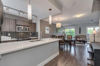 "Photo 3: 208 2110 ROWLAND Street in Port Coquitlam: Central Pt Coquitlam Townhouse for sale in ""Aviva on the Park"" : MLS®# R2442620"