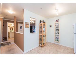 Photo 4: 404 3065 PRIMROSE LANE in Coquitlam: North Coquitlam Condo for sale : MLS®# R2428749
