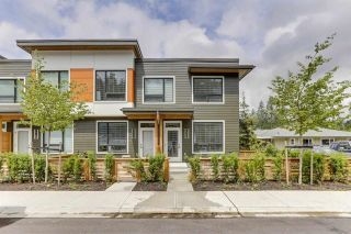 """Photo 1: 409 3021 ST GEORGE Street in Port Moody: Port Moody Centre Townhouse for sale in """"GEORGE by MARCON"""" : MLS®# R2604134"""